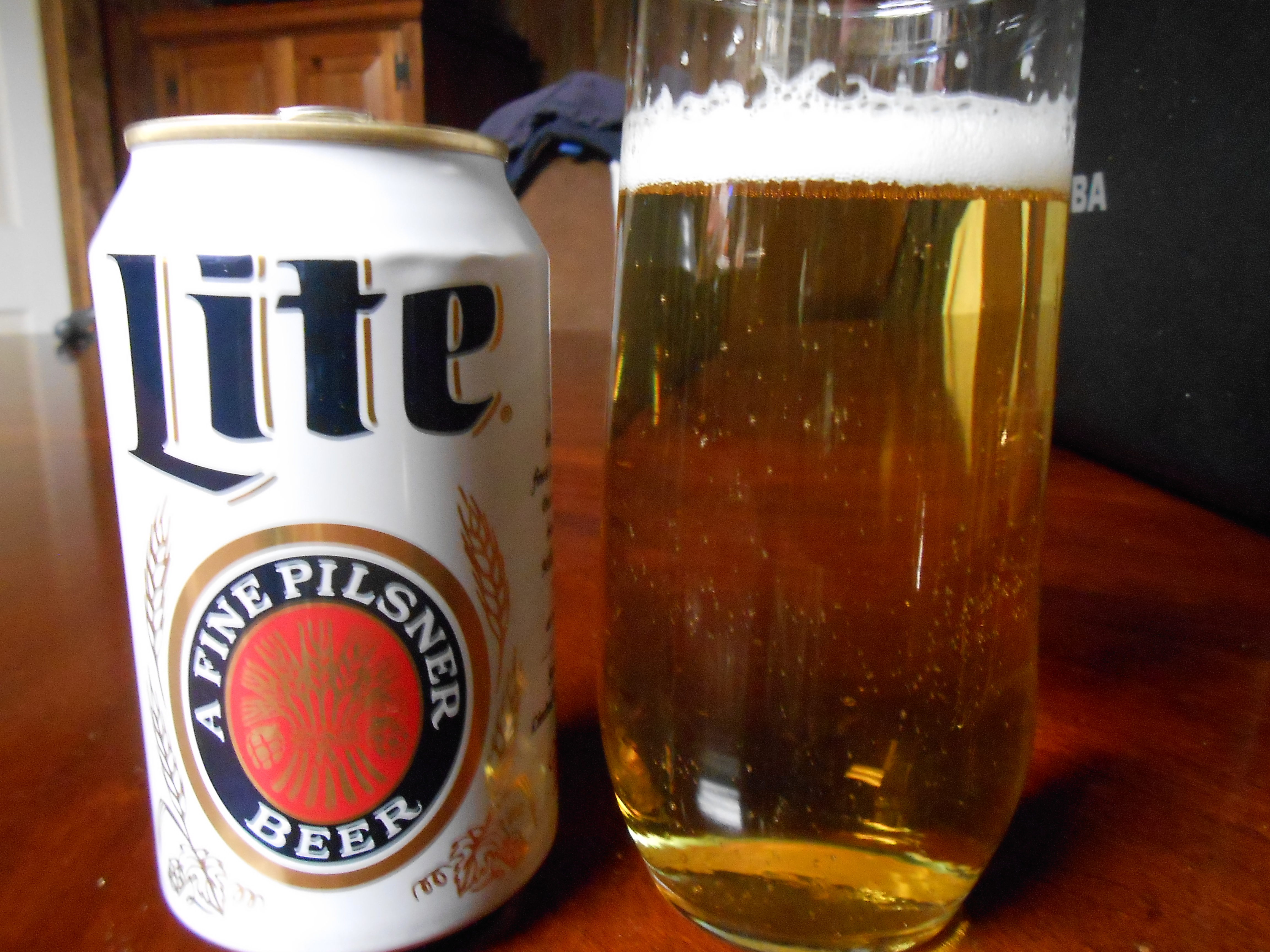 astronaut drinking miller lite beer on the moon - photo #3